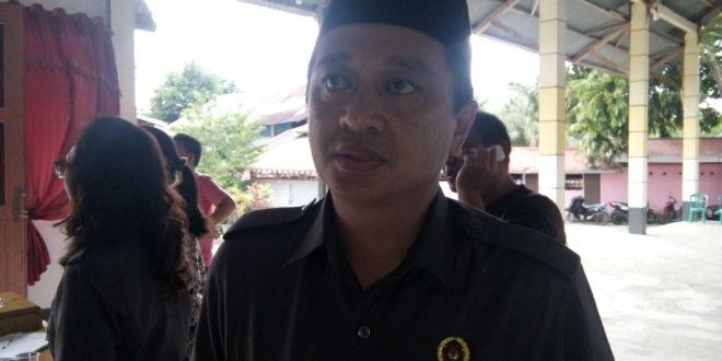 Komisioner KPU Kotamobagu Iwan Himawan Manoppo, SE MM