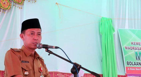 Bupati Bolsel saat memberikan sambutan pada acara peresmian Madrasah Aliyah Nurul Huda Ilomata