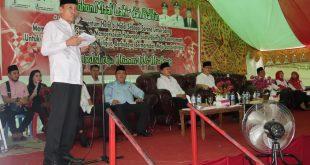 Bupati Bolsel Iskandar Kamaru saat membacakan sambutan pemerintah pada kegiatan Halal Bil Halal pasca Idul Fitri 1440 Hijriayah dan sekaligus acara pelantikan PMI Bolsel yang baru